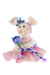 White toy pig in a pink skirt