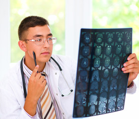 Young doctor looking at tomography brain