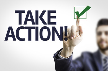 Business man pointing the text: Take Action!