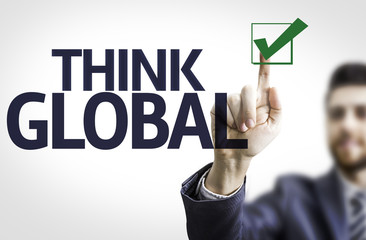Business man pointing the text: Think Global