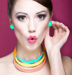 Attractive surprised young woman, beauty and  fashion concept
