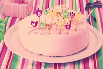 Sweet birthday with candles cake on plate
