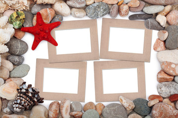 Paper Vintage photo frame with red starfish and pebbles