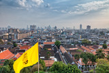 Panorama of Bangkok with buddhist flag