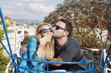Couple on a Ferris wheel