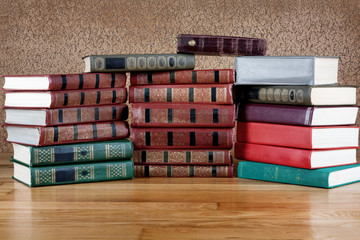 Pile of old books on a beautiful wooden table