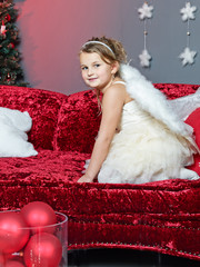 Cute girl waits for Santa Claus on Christmas Eve