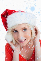 Blonde woman putting on the santa claus hat