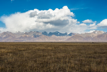 Incredible color of the sky and clouds over flat Tibetan plain