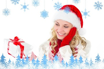 Composite image of festive blonde smiling at present