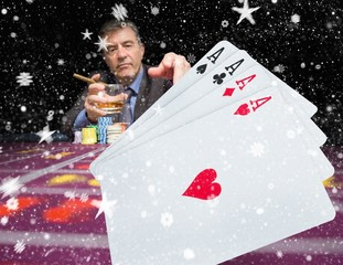 Gambler holding whiskey with digital hand of cards