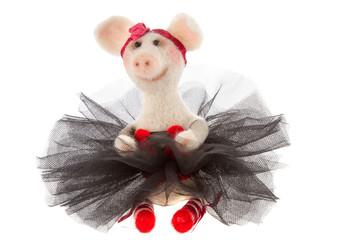 White toy pig in a tutu
