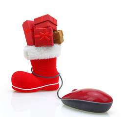 Santa Claus boot with gift boxes connected to a computer mouse
