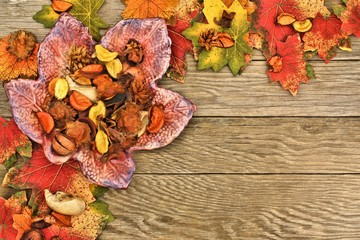Autumn border over a wood background with leaves and decor
