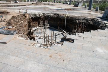 Sinkhole in Sidewalk