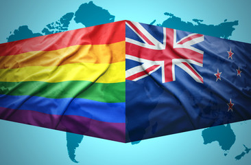 Waving New Zealand and Gay flags