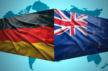 Waving New Zealand and German flags