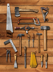 Old carpenter hand tools on wood