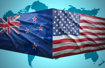 Waving New Zealand and American flags
