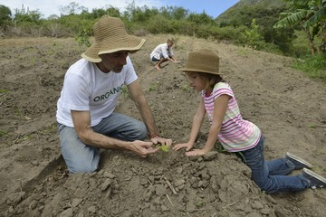 father and daugther planting
