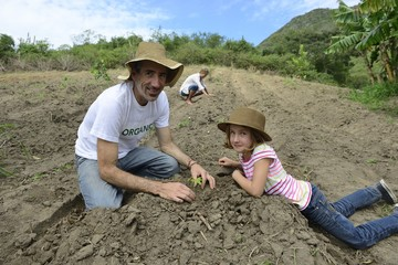 father and daughzer planting