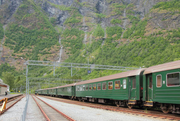 Tracks and passenger train. Flom, Norway