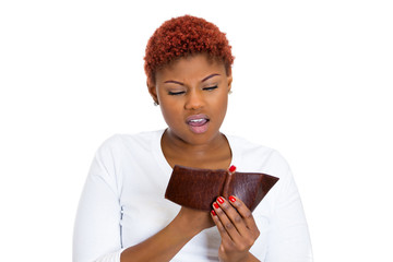Unhappy young woman showing empty wallet