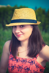 young sexy summer girl wearing a hat