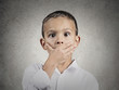 Child with astonished, shock face expression, grey background