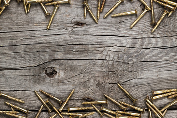 yellow screws on the wooden table