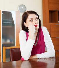 Sad  woman at table