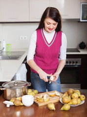 Smiling woman cutting pears for pear jam