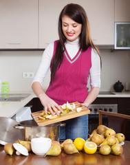 Brunette girl cooking pear jam