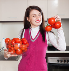 Portrait of happy  woman with red tomatoes