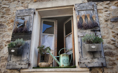 window in France with dried lavendar and herbs