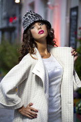 Young beautiful model in a stylish designer clothes