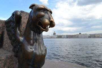 St. Petersburg. Bronze sculpture of a griffin against Neva