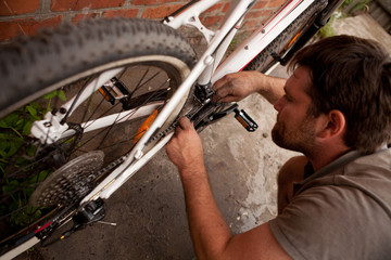 Serviceman repairing a bicycle tire with tools