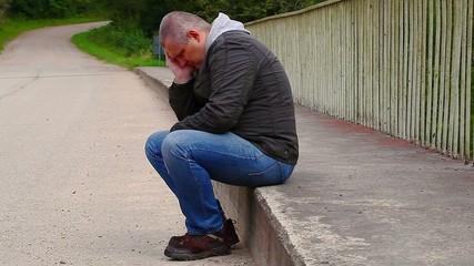 Depressed man  on the bridge