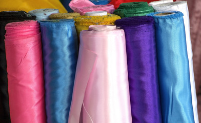 Roll of Silk Fabric display in fabric shops.