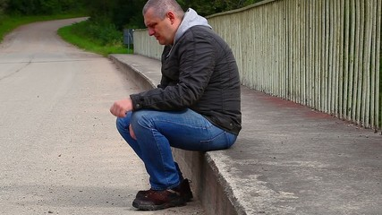 Depressed man nervously moving their hand