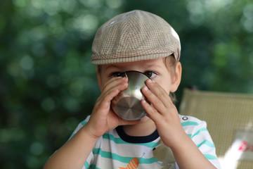 Child drinks tea