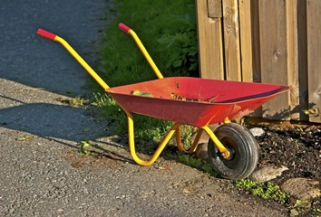 Childrens wheelbarrow for play and gardening work.