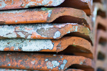 Stack of old roofing tiles with nice pattern.