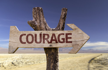 Courage wooden sign with a desert background