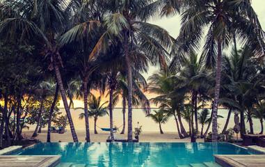 swimming pool on tropical beach