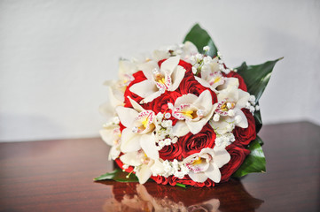Beautiful bouquet of rose flowers, on table. Wedding bouquet