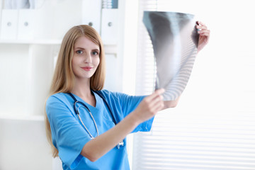 Female doctor showing x-ray at hospital