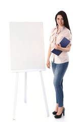 Young woman standing near board with folder