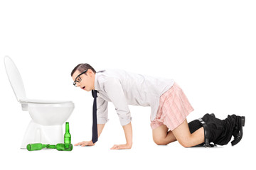 Wasted young man crawling to a toilet